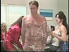 guy getting wrapped in plastic